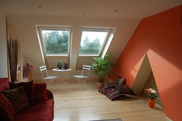 Bright loft room with wood flooring