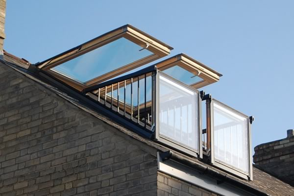 Balcony windows opening out from roof