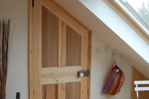 Internal door angled to match sloping ceiling